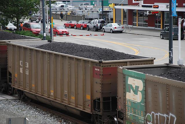 A load of coal moves past the Olympic Sculpture Park in Seattle. Coal export out of the area is hot topic of debate.