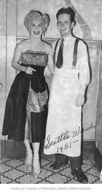 "Billy DeVoe with a bartender at the Garden of Allah, 1951. Billy DeVoe frequently emceed and performed at the Garden of Allah. He has been described as the ""blonde Lana Turner"" and was known for a Southern accent and sexually suggestive, campy routines."