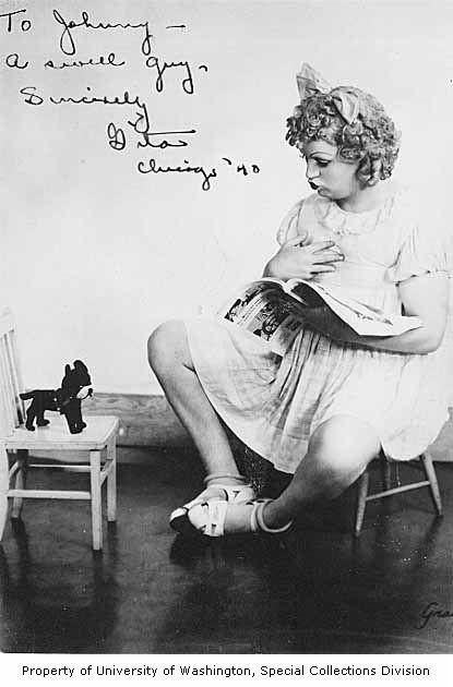 "Gita Gilmore dressed as a young girl, sitting on a small chair and reading to a stuffed dog, 1940.  From his ""Baby Snooks"" routine at the Garden of Allah."