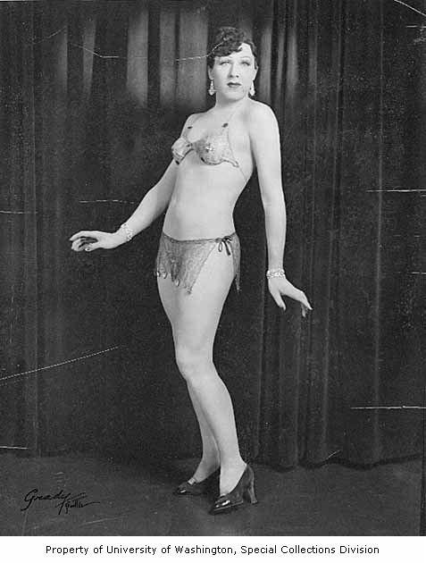 "Jackie Starr in strip tease costume, 1939. Known as ""the most beautiful man in America."" Headlined at The Garden of Allah for 10 years. Married a man named Bill Scott. The two remained together until Starr's death in the late 1960s."
