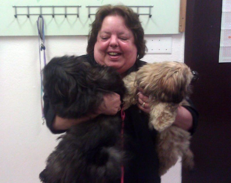 Nancy Thomas, owner of Lickety Clips Grooming Salon in Mount Vernon, holding Chunk and Chloe.