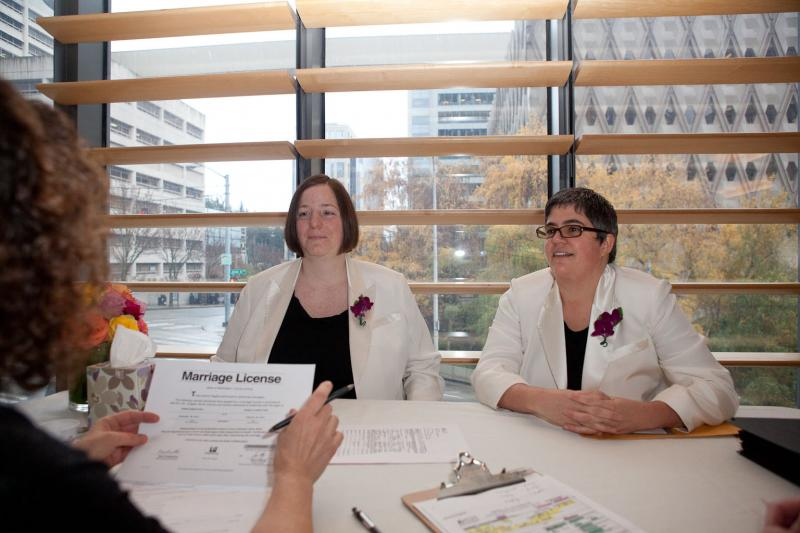 Danielle Yung (left) and Robin Wyss meeting with the judge before their wedding ceremony on December 9, 2012.