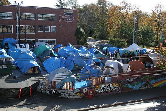Seattle's homeless tent city, Nickelsville, has been moved from place to place over the years, including across from the University of Washington (as pictured) and most recently in West Seattle. But Seattle City Council wants it to close.