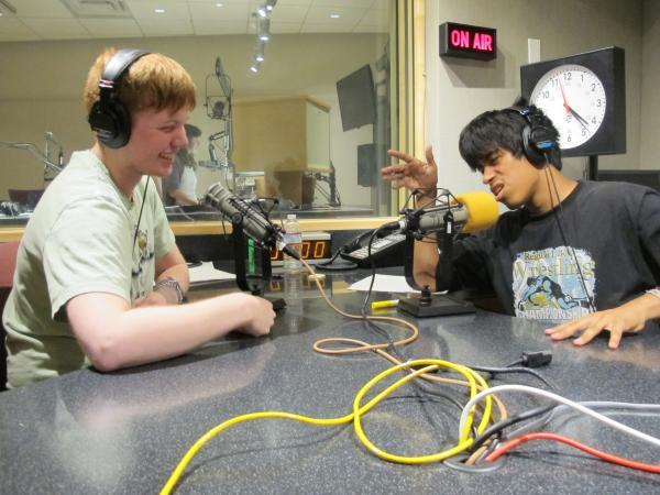 Hosts Isaac Noren (left) and Carlos Nieto in KUOW's studio recording this show.