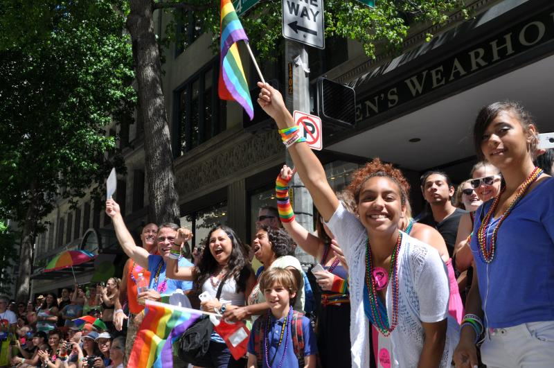 Colorfully-dressed crowds lined the street for Seattle's Pride Parade.