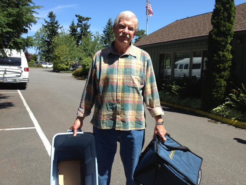 Retired professor and volunteer Michael Newbrough delivers meals to seniors. He is often the first to notice a decline in his clients' health.