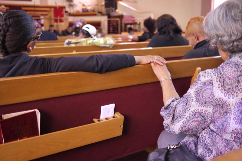 Community members sit together during a prayer vigil in central Seattle for Trayvon Martin.