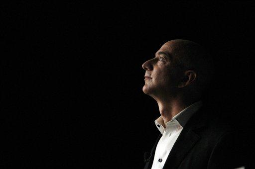 Jeff Bezos  is illuminated by a display screen at the introduction of the new Amazon Kindle Fire HD and Kindle Paperwhite in Santa Monica, Calif., Sept. 6, 2012.
