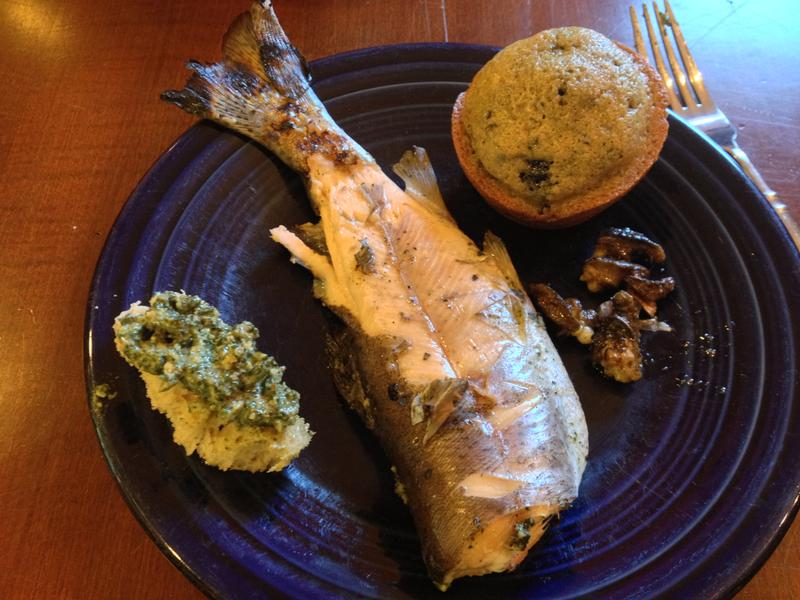 Foraged dinner for Melany Vorass Herrera and her husband Carlos Hererra: wild stinging nettle pesto, trout from a local lake, butter-fried invasive snails (escargot) and muffins with locally-harvested wild mulberries.