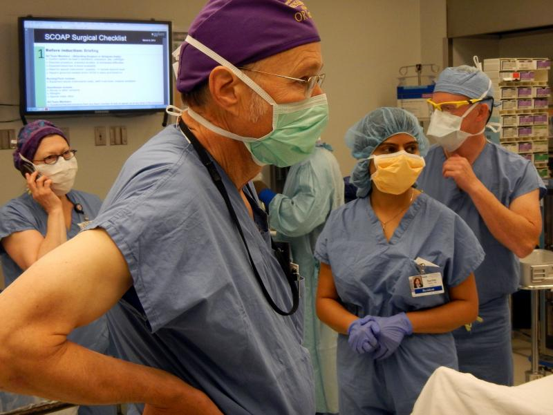 "UW Medical Center surgical team during a pre-surgery ""safety pause."""
