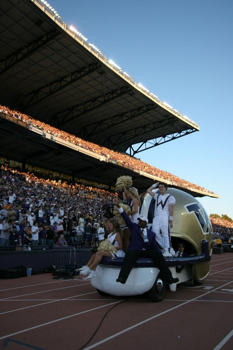 A long-standing U.W. tradition, the Husky Helmet Car circles the field after a Husky football score. The car is being retired and donated to MOHAI.