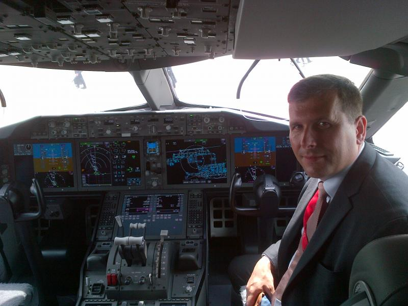 Michel Merluzeau, aerospace consultant, in the cockpit of a Boeing 787
