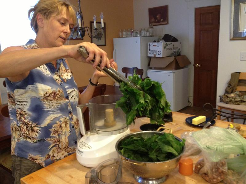 Melany handles stinging nettles carefully in the kitchen.