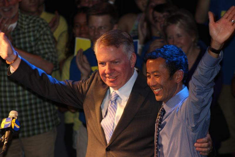 Ed Murray with his partner Michael Shiosaki on stage at the Crocodile after his speech to supporters.