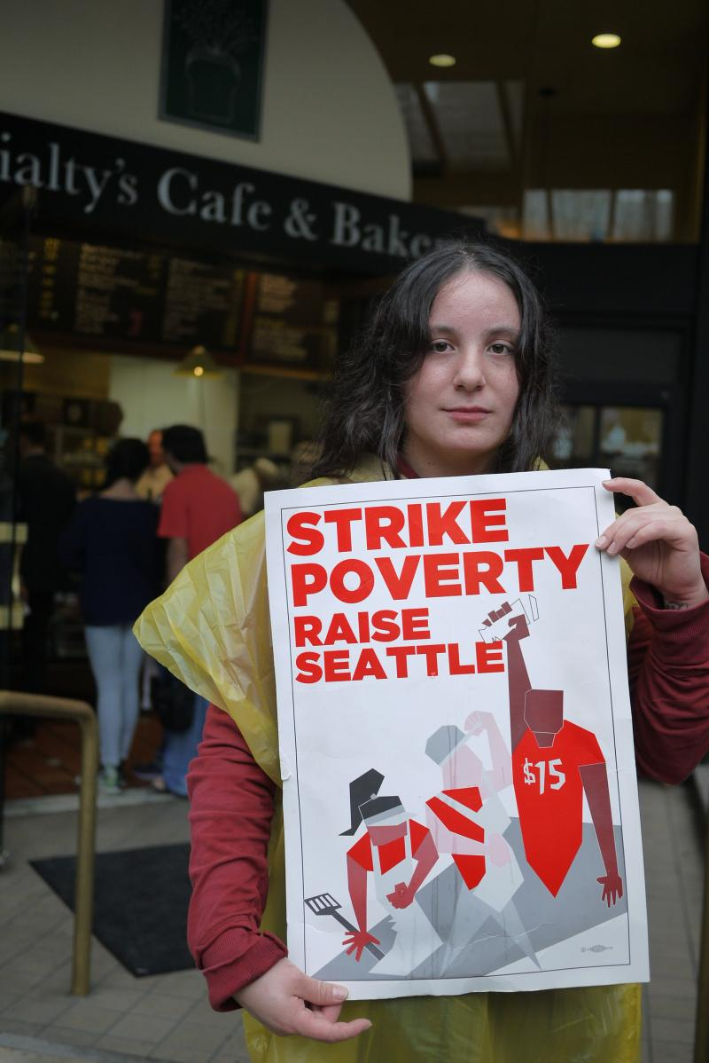 A fast-food worker participates in a one-day strike to encourage a $15 minimum wage in Seattle.