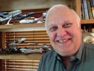Scott Hamilton, aerospace consultant, in his office complete with model planes