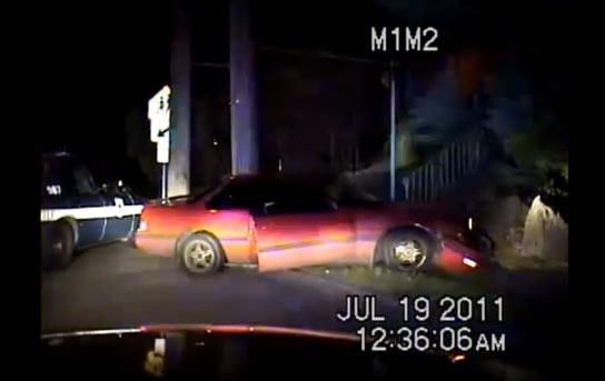 Screenshot from the dash-cam video from Seth Germain's arrest, showing the stolen car crashed into a ditch.