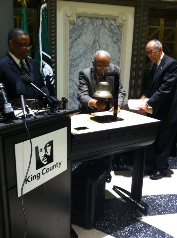 Reverend Samuel McKinney ringing a bell in honor of the March on Washington's 50th anniversary.