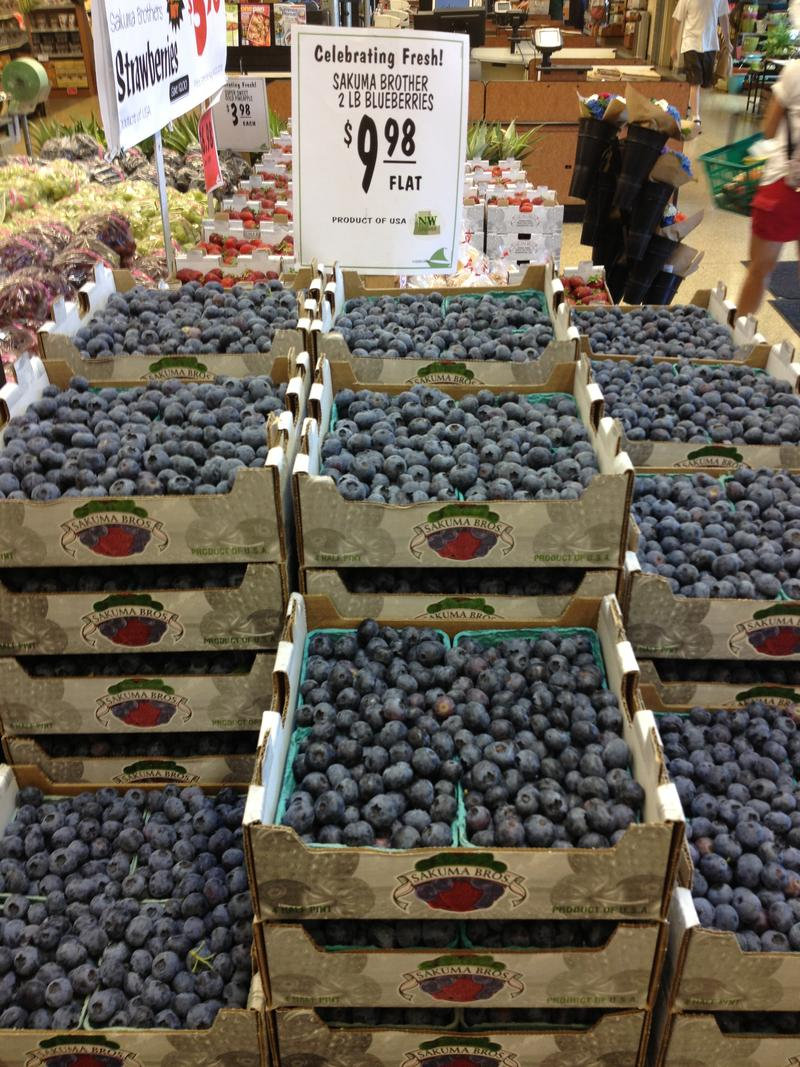 Flats of blueberries from Sakuma Brothers Farms at Ballard Market in Seattle.