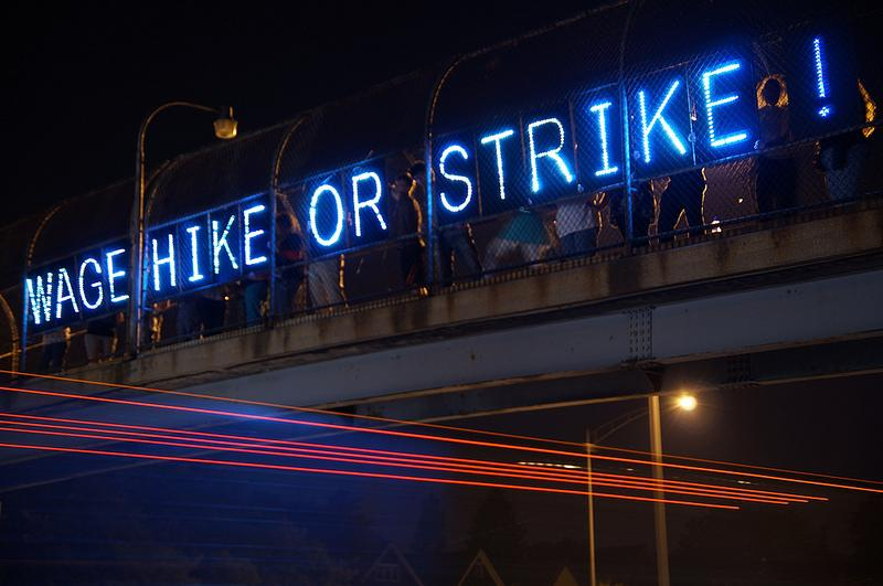 Wage strike on an overpass in Milwaukee, July 25, 2013.