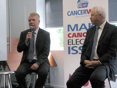 Seattle mayoral candidates Ed Murray and Mike McGinn at a forum on life sciences and cancer research.