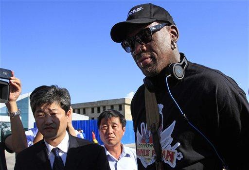 Former NBA star Dennis Rodman arrives at Pyongyang airport, North Korea, Tuesday.