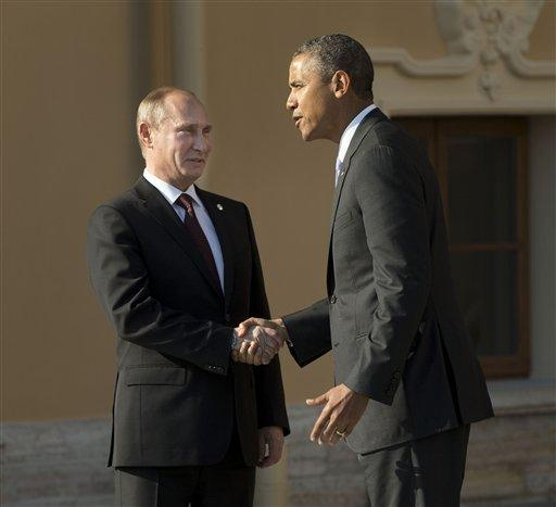 President Barack Obama shakes hands with Russia's President Vladimir Putin during arrivals for the G-20 summit at the Konstantin Palace in St. Petersburg, Russia, Thursday.