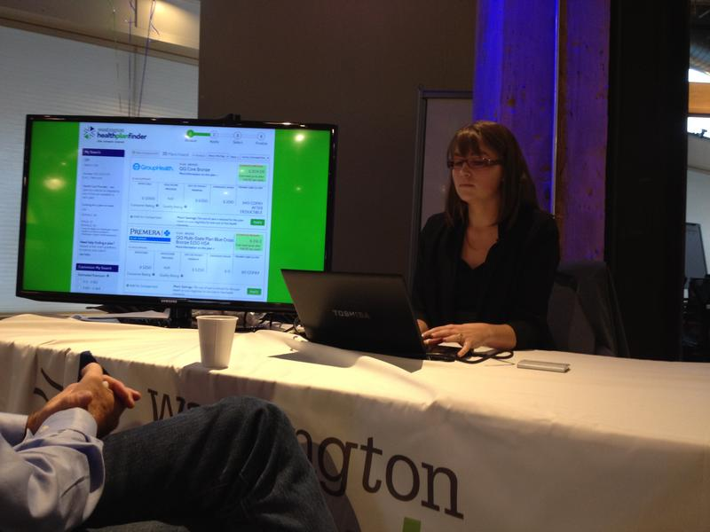 Nelly Kinsella of the Washington State Health Exchange Benefit Exchange shows a reporter how to navigate the new online market system, September 30, 2013.