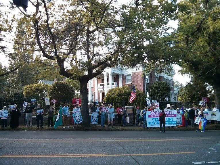 Protesters line the street outside the Russian consulate in Seattle's Madison Valley.