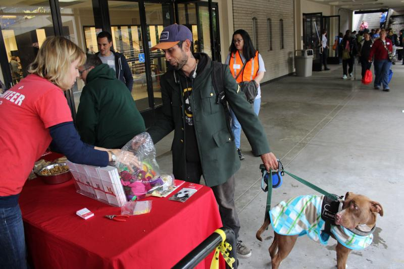 Richard Cote received treats, toys and clothing for his dog Lexi from volunteers at the Seattle Humane Society. This was part of an event for homeless people put on by United Way of King County.