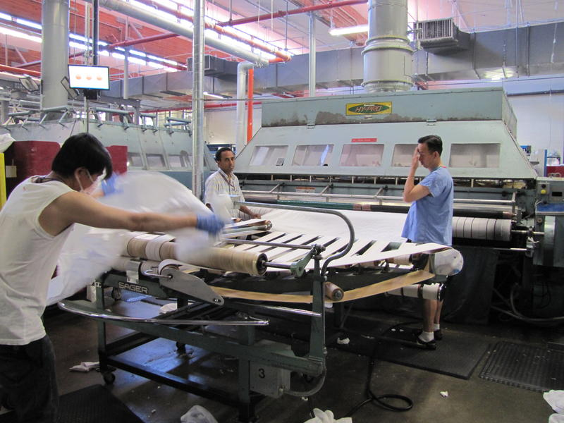 Workers at UW's consolidated laundry facility.
