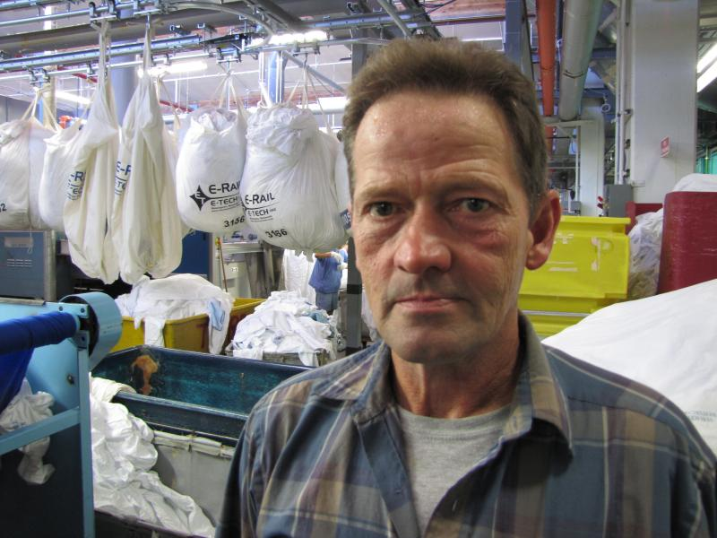 Mike Mitzel, maintenance mechanic for UW's consolidated laundry facility.