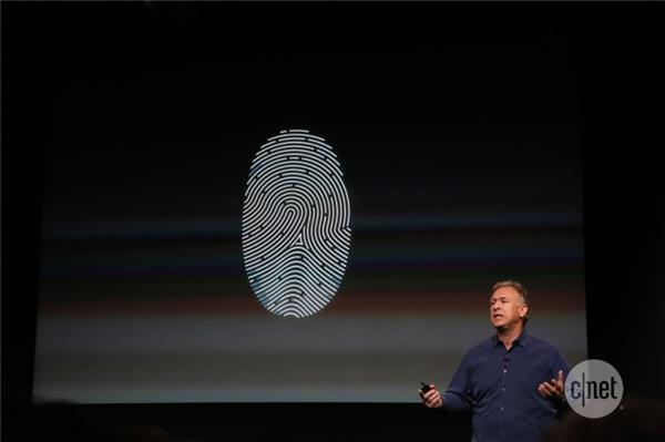 Apple's Phil Schiller unveils the new iPhone 5S yesterday with new Touch ID technology.