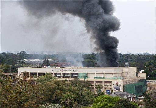 A plume of black smoke billows over the Westgate Mall, in Nairobi, Kenya yesterday.