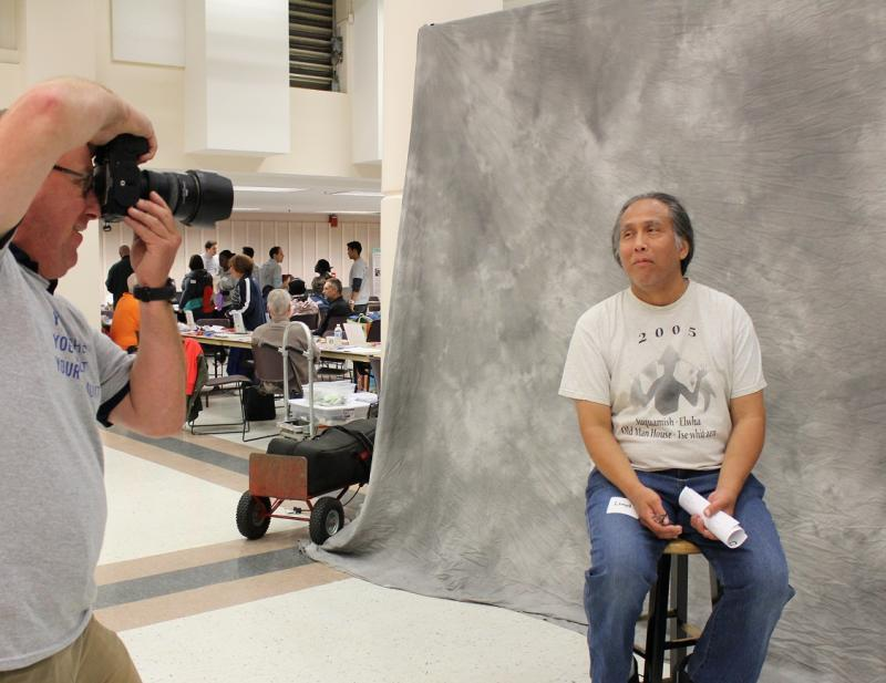 Professional photographer Curt Nakon takes Lloyd Dalton's portrait at the Resource Exchange for homeless people at Seattle Center.