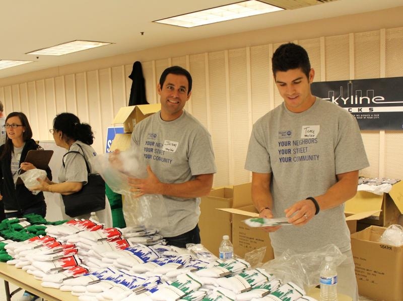 "Jason Mesnick of ABC's ""The Bachelor"" fame helps hand out socks donated by Tony Bacon's Skyline Socks Company at the United Way Resource Exchange for homeless people."