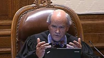 State Supreme Court Justice Charles Wiggins said the death penalty case can proceed.