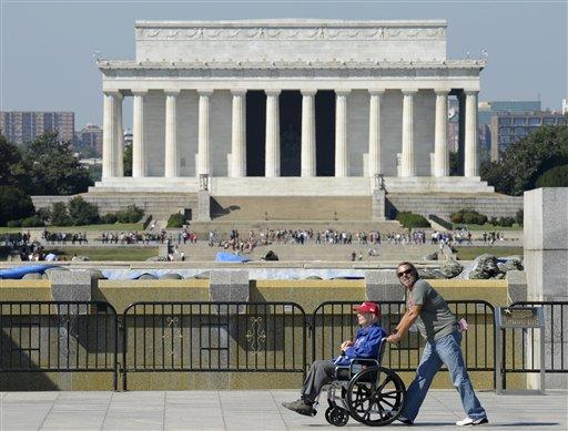 World War II veterans visit the World War II Memorial in Washington on Wednesday despite barriers erected after the shutdown.