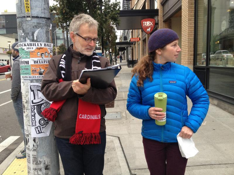 Fred Strong and Laura LeBlanc volunteer for Washington's annual bike and pedestrian count at a corner on Capitol Hill.