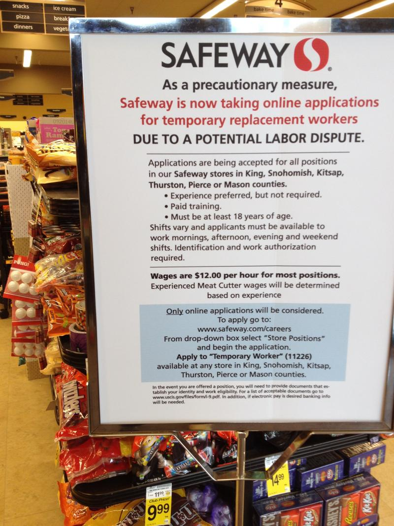 A Safeway in Seattle's University District advertises checker positions ahead of a possible worker strike.