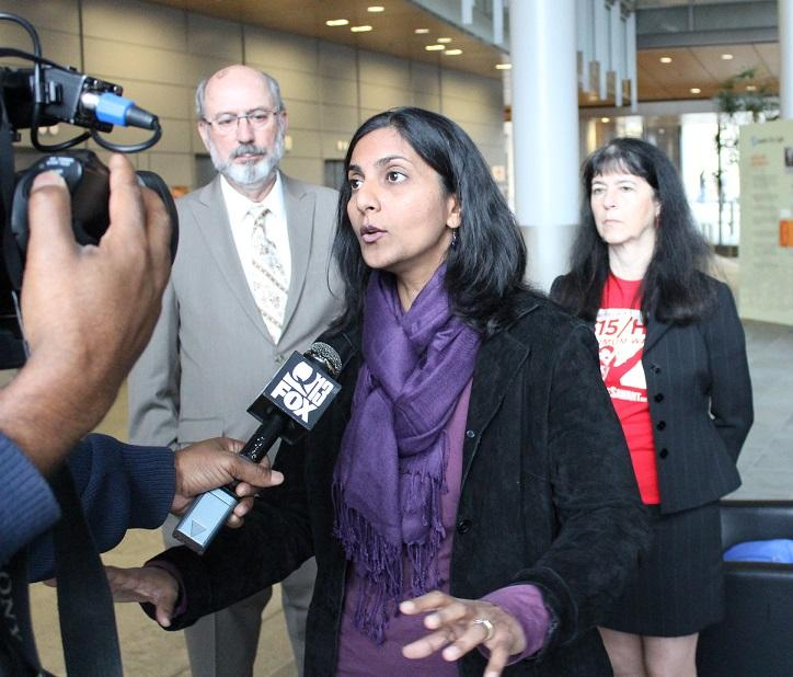 City Council candidate Kshama Sawant, a member of the Socialist Alternative Party, with Democratic Party supporters Daniel Norton and Jeanne Legault