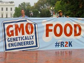 Protesters hold a sign in front of the White House advocating for GMO labeling, October 19, 2011.