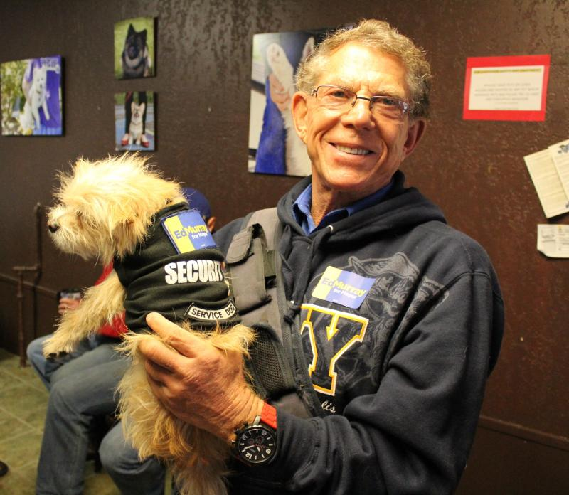 Volunteer Gordon Myers and his dog, Skipper, prepare to canvas for Ed Murray