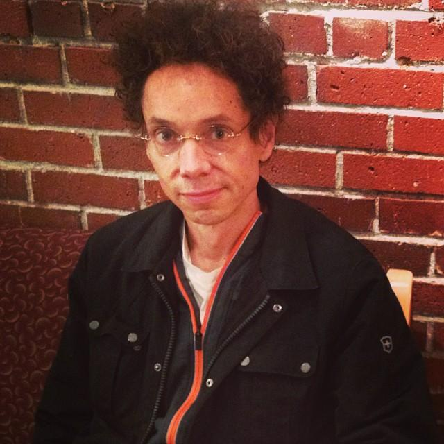 Writer Malcolm Gladwell waits in KUOW's green room before an interview with The Record's Ross Reynold's.