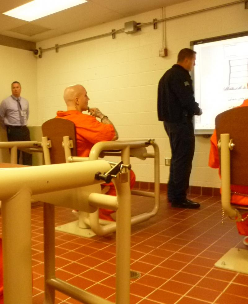 Inmate Joshua Burgoyne, 31, watches Sgt. Mike Acree explain how negative self talk can be turned around. The program for offenders in long term isolation is an attempt to help lower infractions while in prison and when they're released.