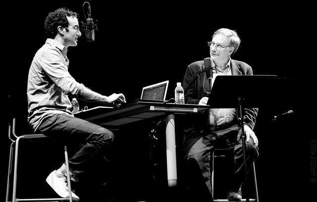 Jad Abumrad and Robert Krulwich on stage in 2011 at the 5th Avenue Theatre in Seattle.