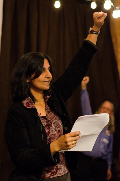 Kshama Sawant pumps her fist in celebration while talking about how the election demonstrates the growing success of the socialist party in Seattle.