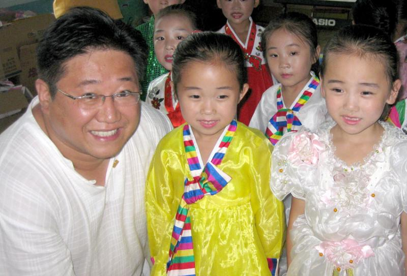 Kenneth with North Korean Children