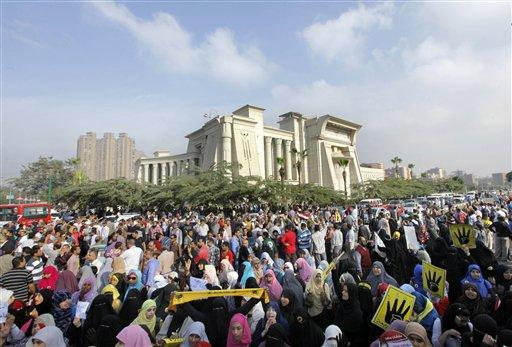 Supporters of Egypt's ousted President Mohammed Morsi protest Morsi's trial in front of the supreme constitutional court in Cairo on Monday, Nov. 4.