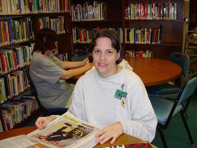 A woman reading in the library of  Gig Harbor's Washington Corrections Center for Women.